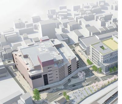 市役所(左)と市立病院(右)、さ...